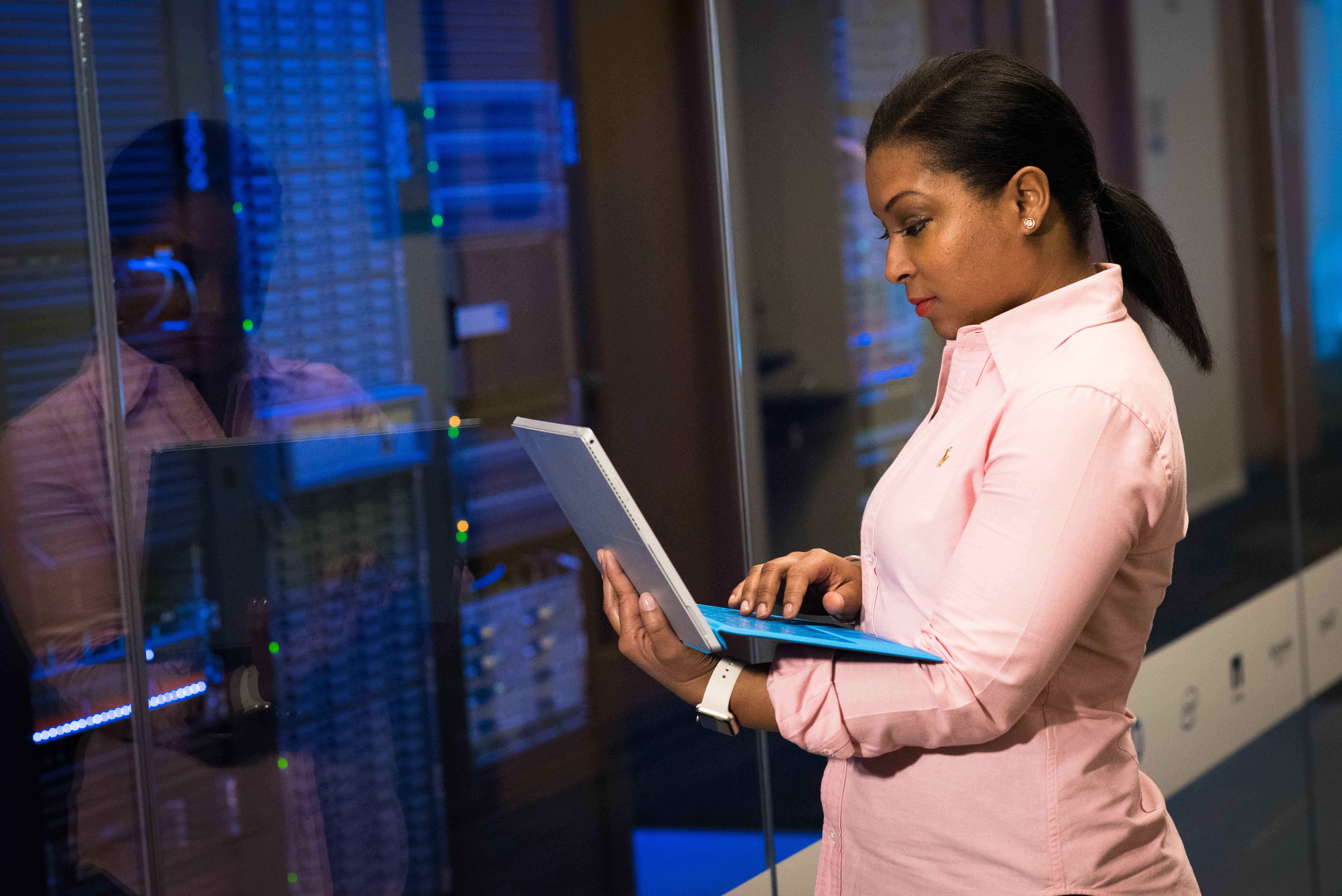 woman with laptop working on servers