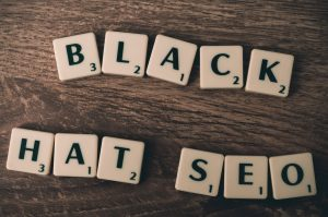 scrabble pieces spelling out black hat seo