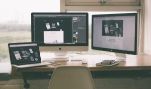 website design and development on three computer screens